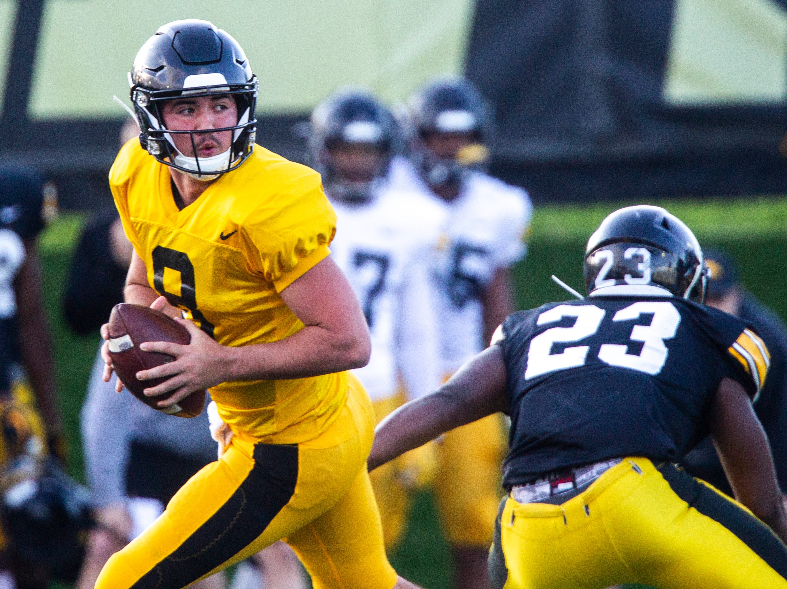 Iowa quarterback Alex Padilla (8) drops back to pass during the final spring football practice, Friday, April 26, 2019, at the University of Iowa outdoor practice facility in Iowa City, Iowa.