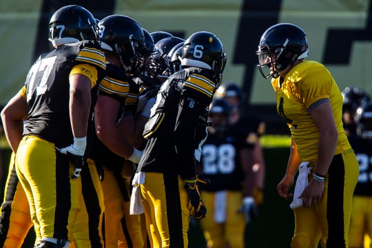 Iowa quarterback Nate Stanley (4) calls a play in the huddle during the final spring football practice, Friday, April 26, 2019, at the University of Iowa outdoor practice facility in Iowa City, Iowa.