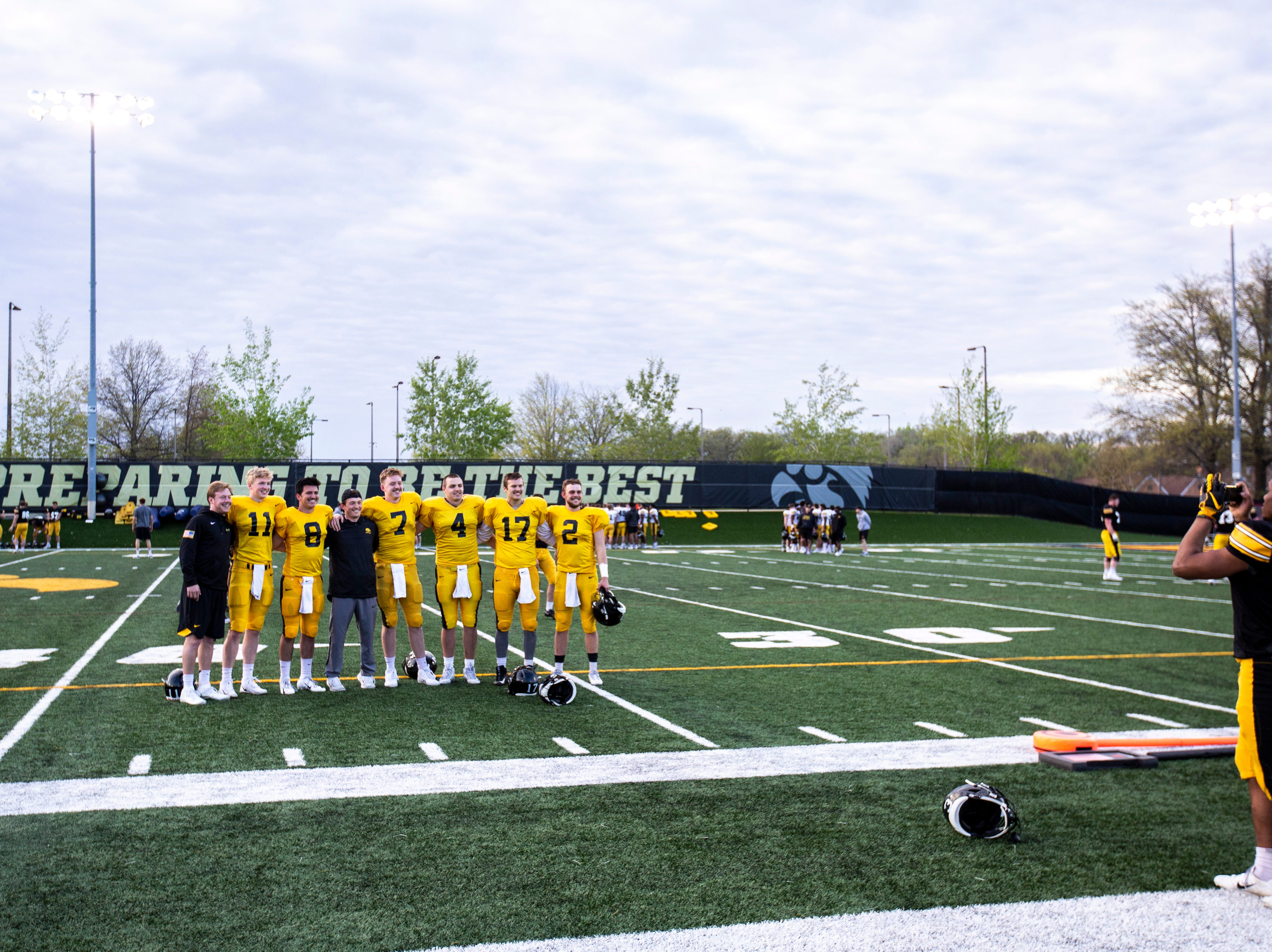Iowa wide receiver Tyrone Tracy Jr. (3) takes a photo of the quarterbacks with freshly shaven mustaches after the final spring football practice, Friday, April 26, 2019, at the University of Iowa outdoor practice facility in Iowa City, Iowa.