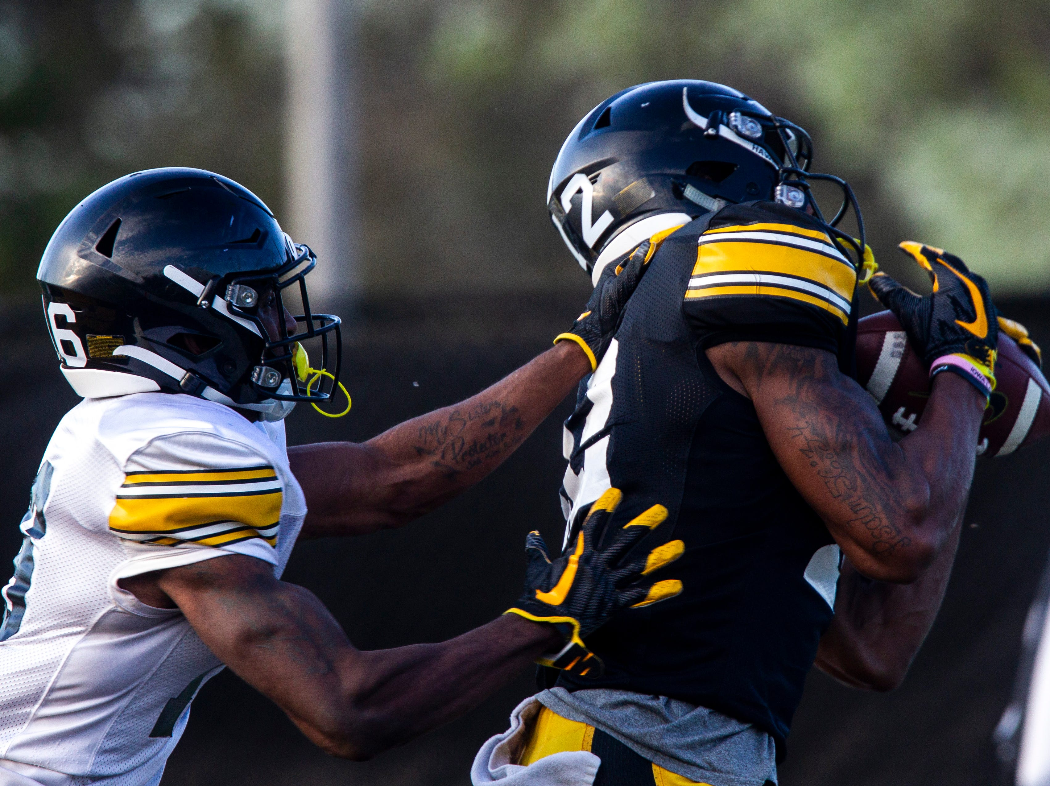 Iowa wide receiver Brandon Smith (12) pulls in a touchdown pass during the final spring football practice, Friday, April 26, 2019, at the University of Iowa outdoor practice facility in Iowa City, Iowa.