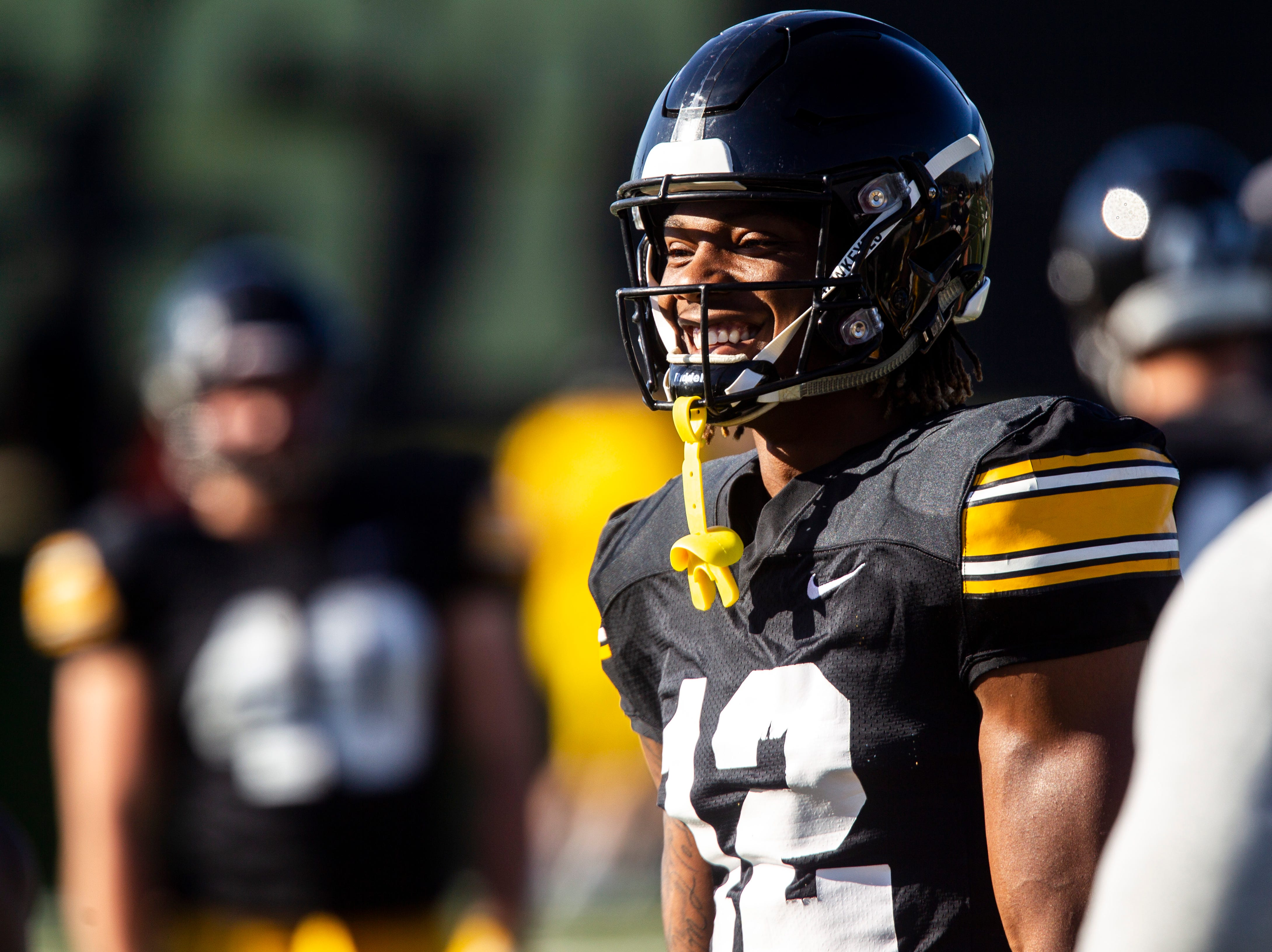 Iowa wide receiver Brandon Smith (12) smiles during the final spring football practice, Friday, April 26, 2019, at the University of Iowa outdoor practice facility in Iowa City, Iowa.