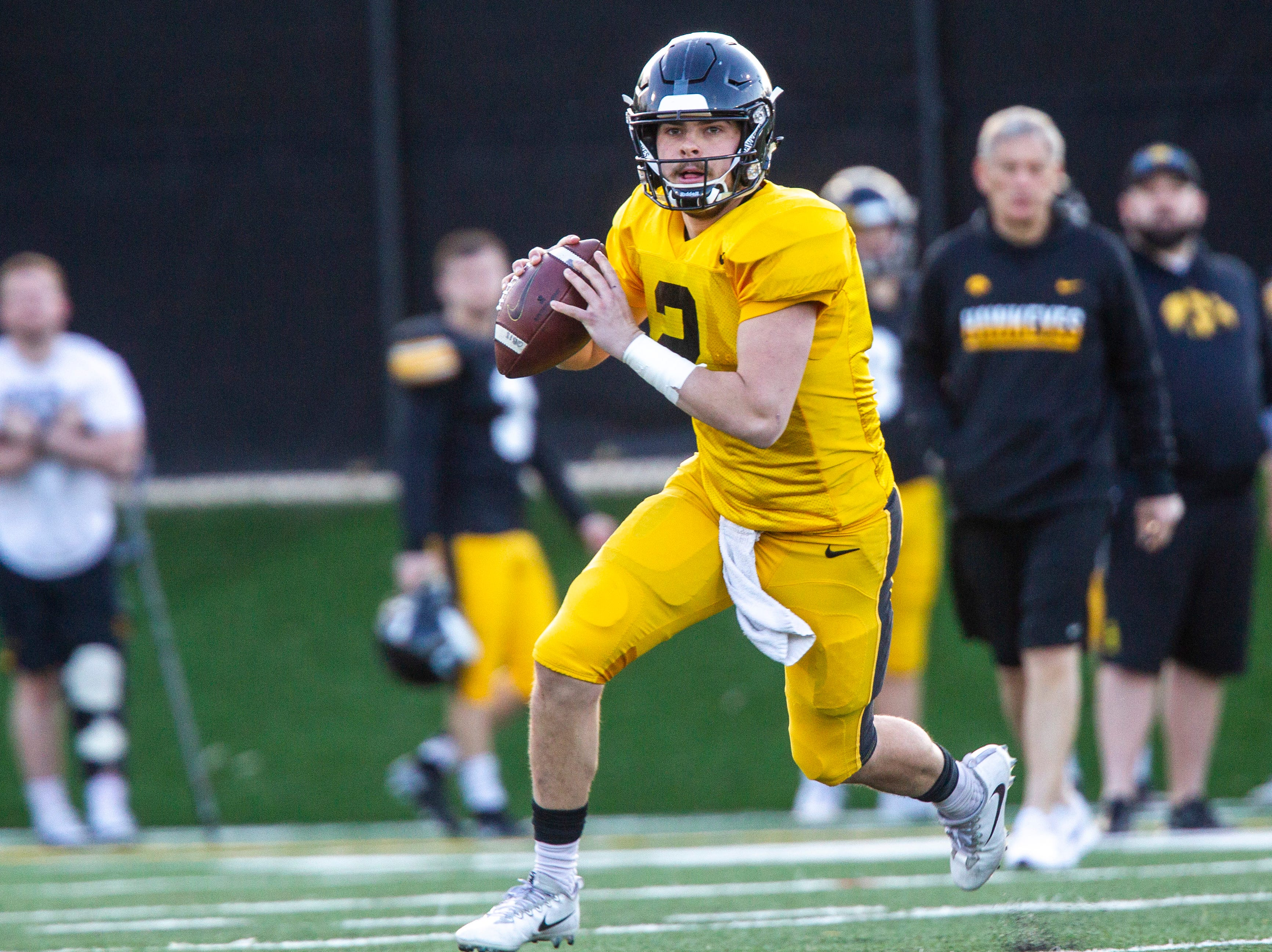 Iowa quarterback Peyton Mansell (2) rolls out to pass during the final spring football practice, Friday, April 26, 2019, at the University of Iowa outdoor practice facility in Iowa City, Iowa.