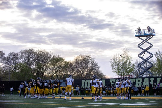 Iowa football players are shown preparing for their final spring practice in April. The Hawkeyes are hoping to add more players to their future swarm this weekend.