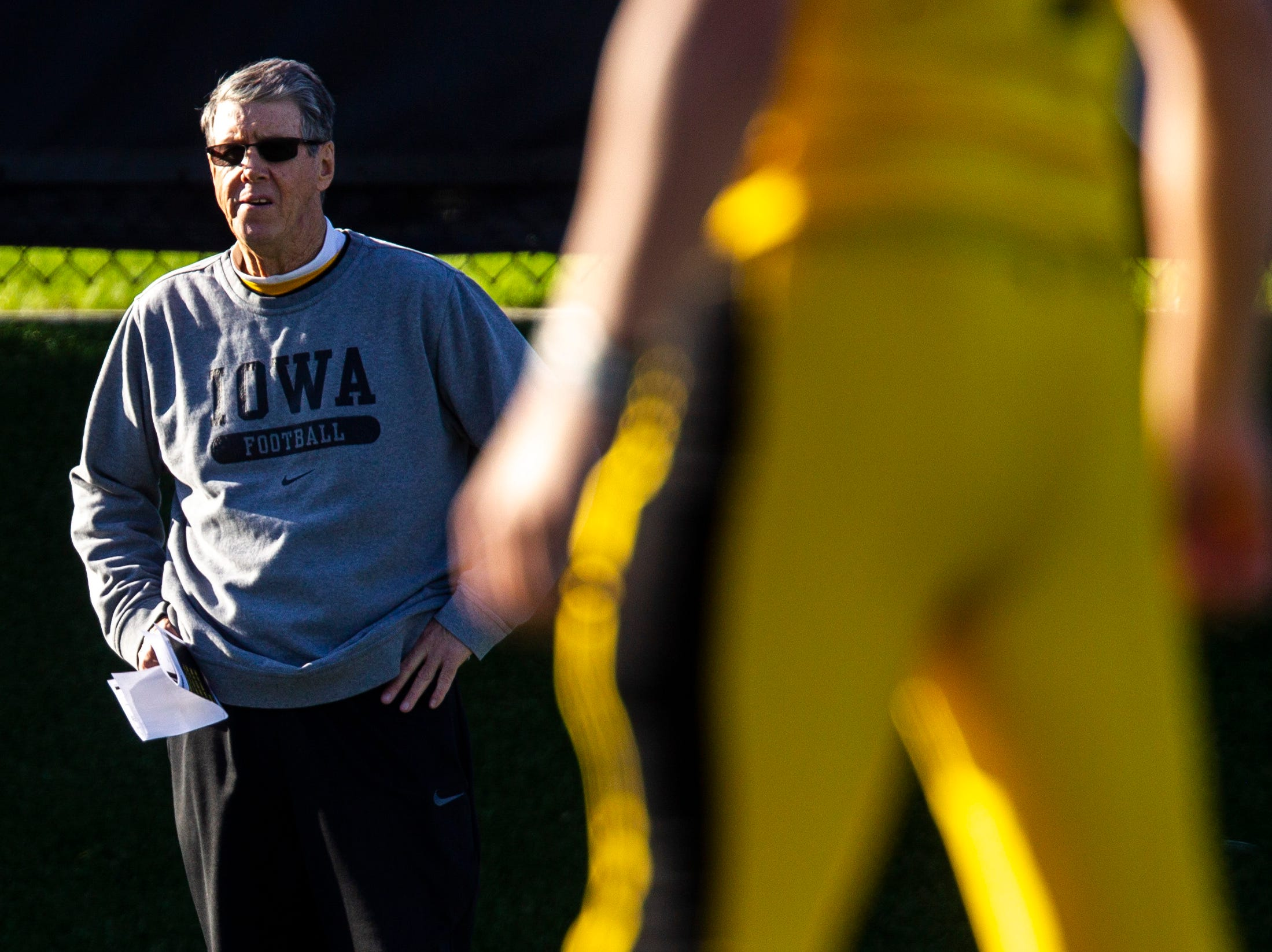 Iowa quarterbacks coach Ken O'Keefe looks on during the final spring football practice, Friday, April 26, 2019, at the University of Iowa outdoor practice facility in Iowa City, Iowa.