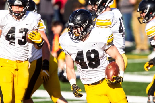 Iowa junior linebacker Nick Niemann (49) is competing for a starting spot this offseason. His father, Jay, will be the Hawkeyes' new assistant coach.