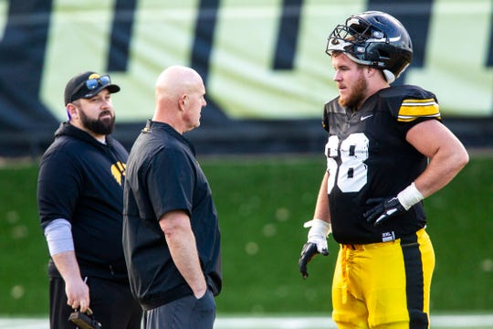 Iowa strength and conditioning coach Chris Doyle, middle, is pictured with offensive lineman Landan Paulsen during the final spring practice. Paulsen's team was running third in Doyle's Hawkeye Championship competition that continues into the summer.