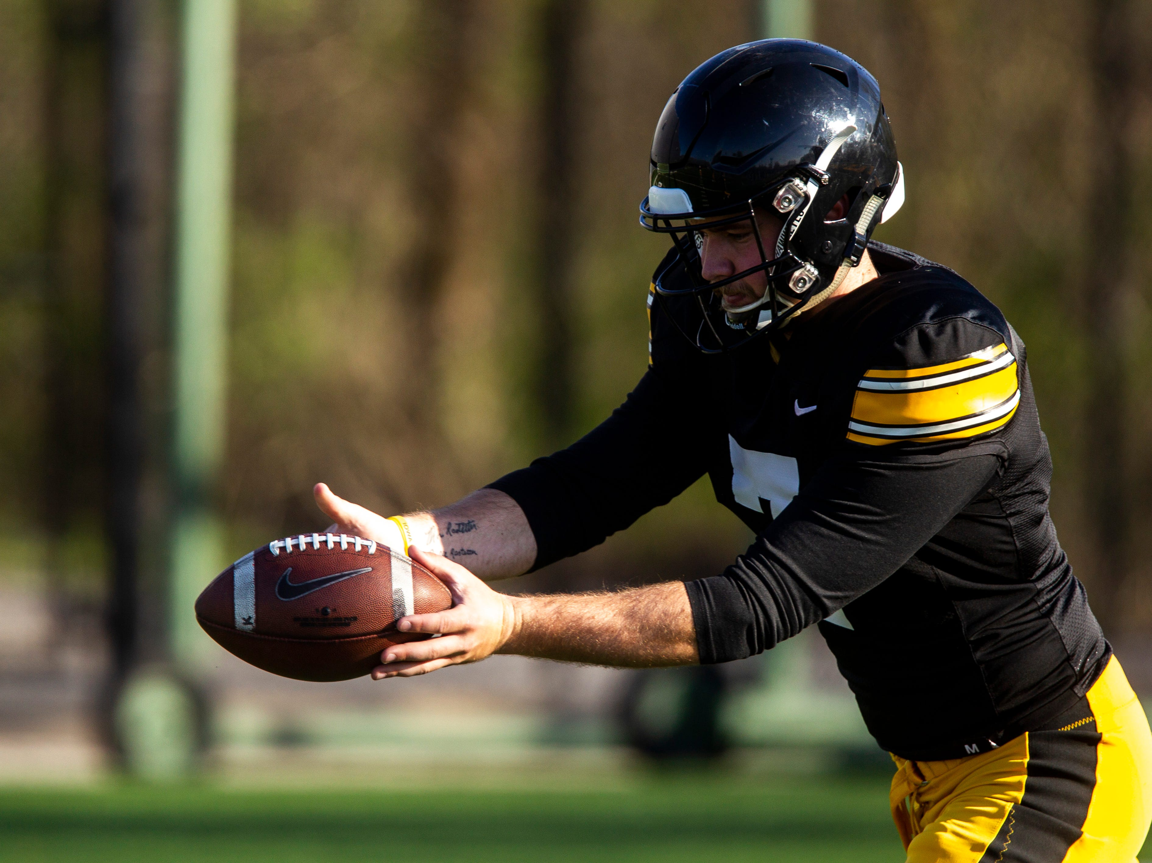 Iowa's Colten Rastetter (7) punts during the final spring football practice, Friday, April 26, 2019, at the University of Iowa outdoor practice facility in Iowa City, Iowa.