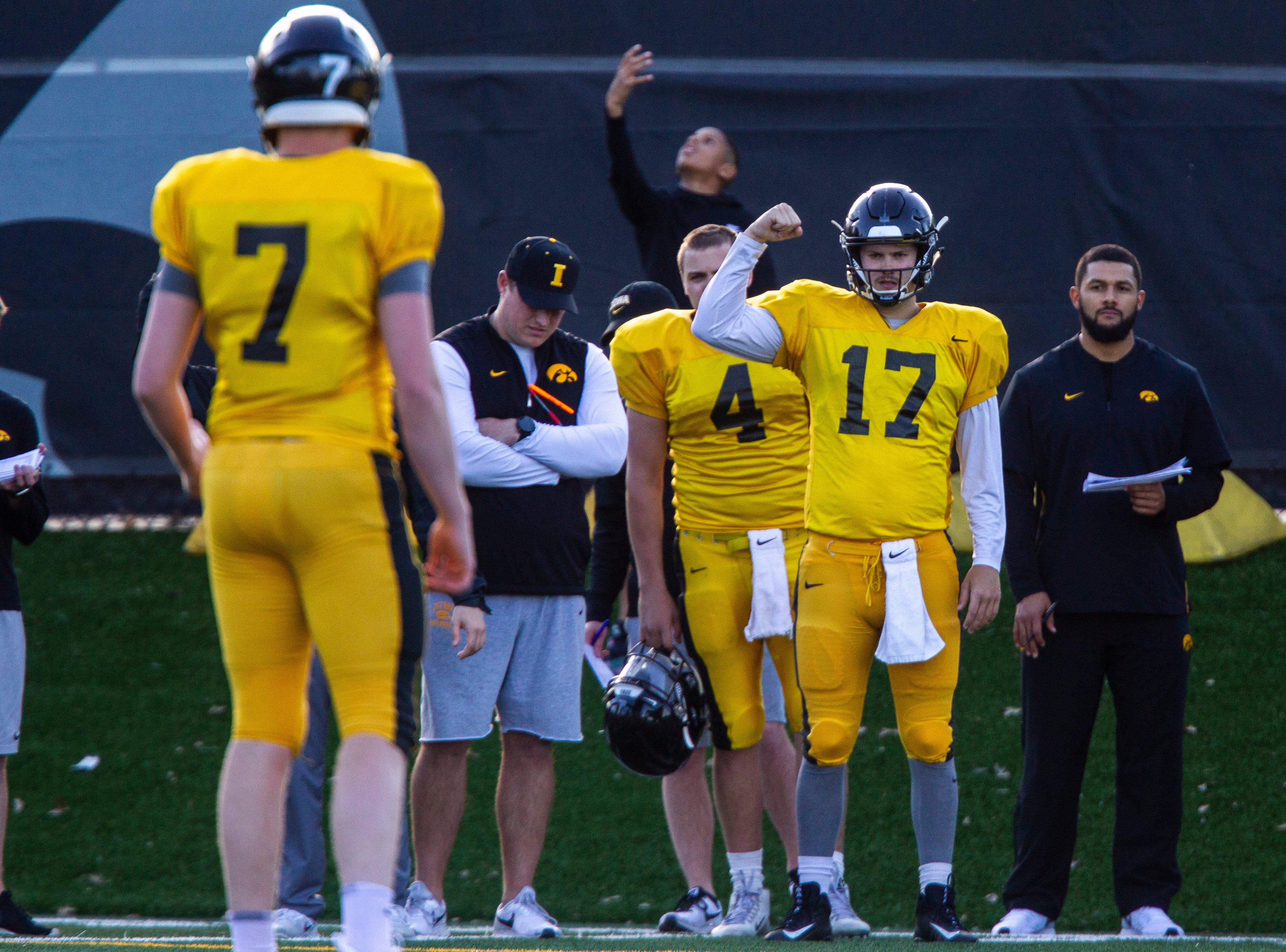 Iowa quarterback Ryan Schmidt (17) gestures to teammates Spencer Petras (7) during the final spring football practice, Friday, April 26, 2019, at the University of Iowa outdoor practice facility in Iowa City, Iowa.