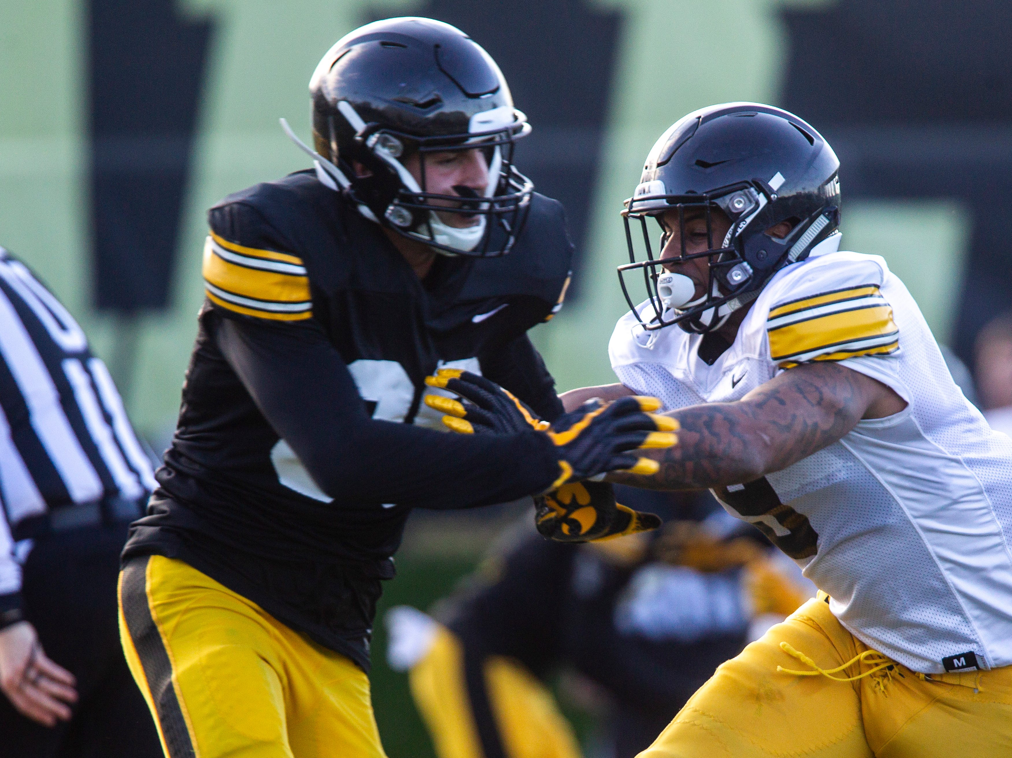 Iowa defensive back Geno Stone (9) defends wide receiver Nico Ragaini (89) during the final spring football practice, Friday, April 26, 2019, at the University of Iowa outdoor practice facility in Iowa City, Iowa.