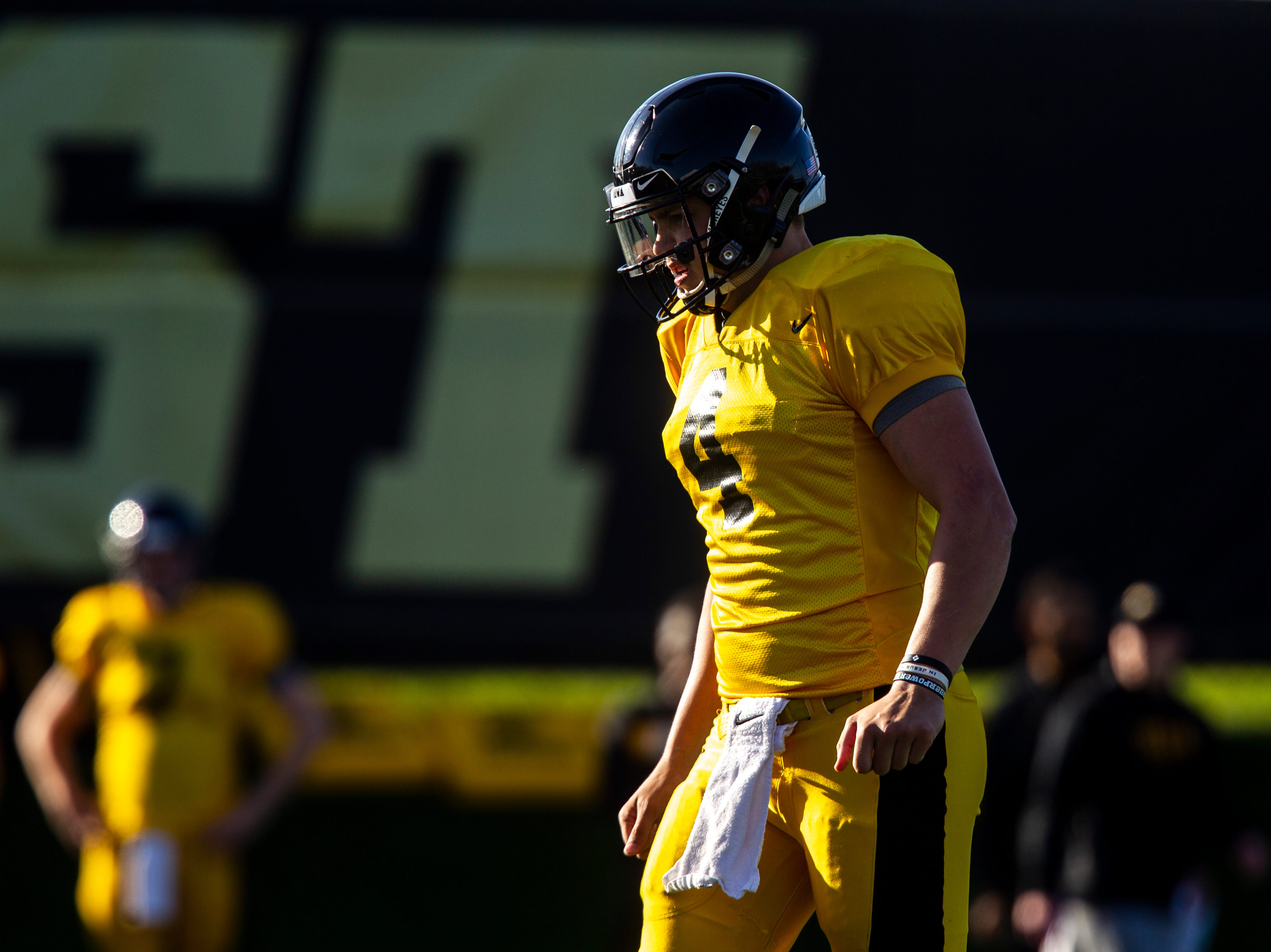 Iowa quarterback Nate Stanley walks up to the huddle during the final spring football practice, Friday, April 26, 2019, at the University of Iowa outdoor practice facility in Iowa City, Iowa.