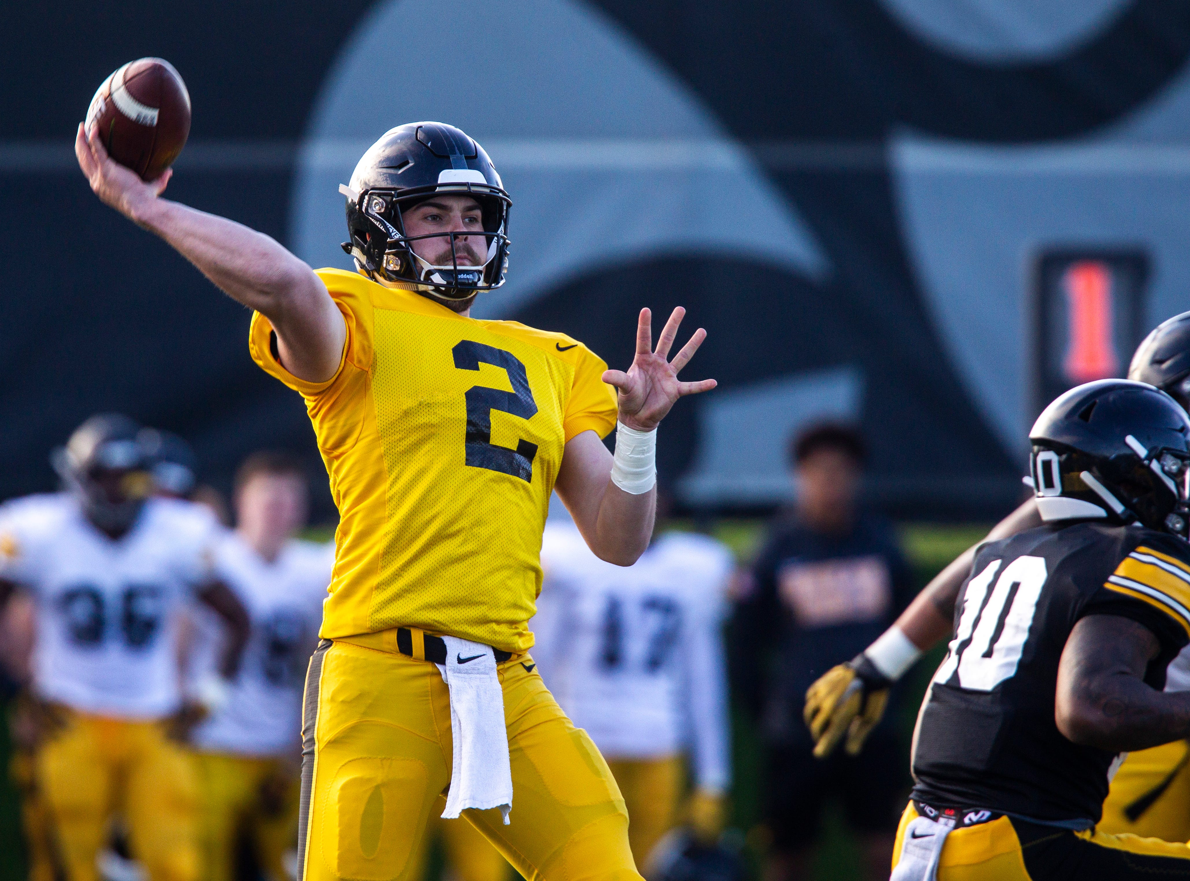 Iowa quarterback Peyton Mansell (2) throws a pass during the final spring football practice, Friday, April 26, 2019, at the University of Iowa outdoor practice facility in Iowa City, Iowa.