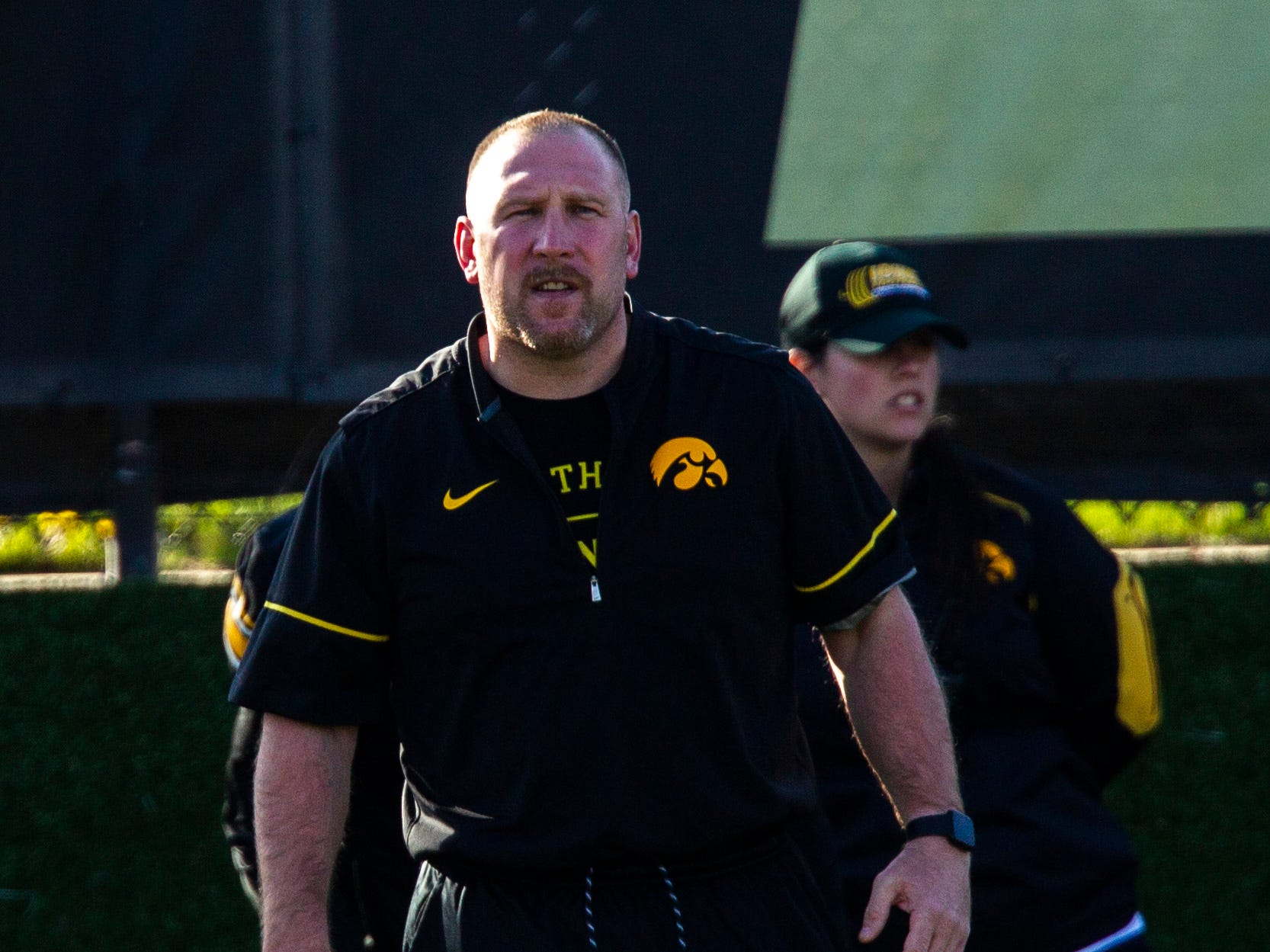 Iowa offensive line coach Tim Polasek calls out to players during the final spring football practice, Friday, April 26, 2019, at the University of Iowa outdoor practice facility in Iowa City, Iowa.