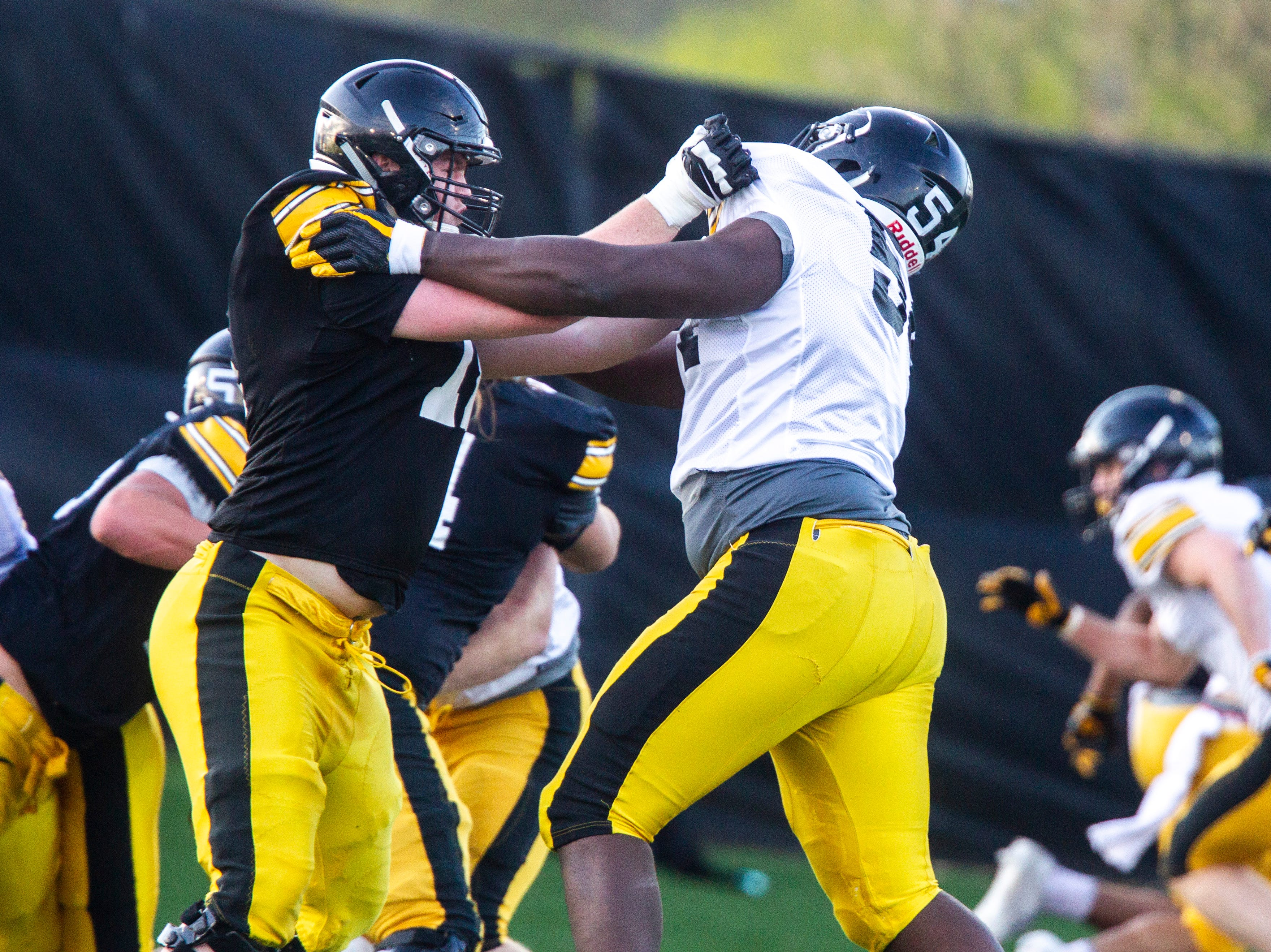 Iowa offensive lineman Mark Kallenberger (71) blocks against defensive tackle Daviyon Nixon (54) during the final spring football practice, Friday, April 26, 2019, at the University of Iowa outdoor practice facility in Iowa City, Iowa.