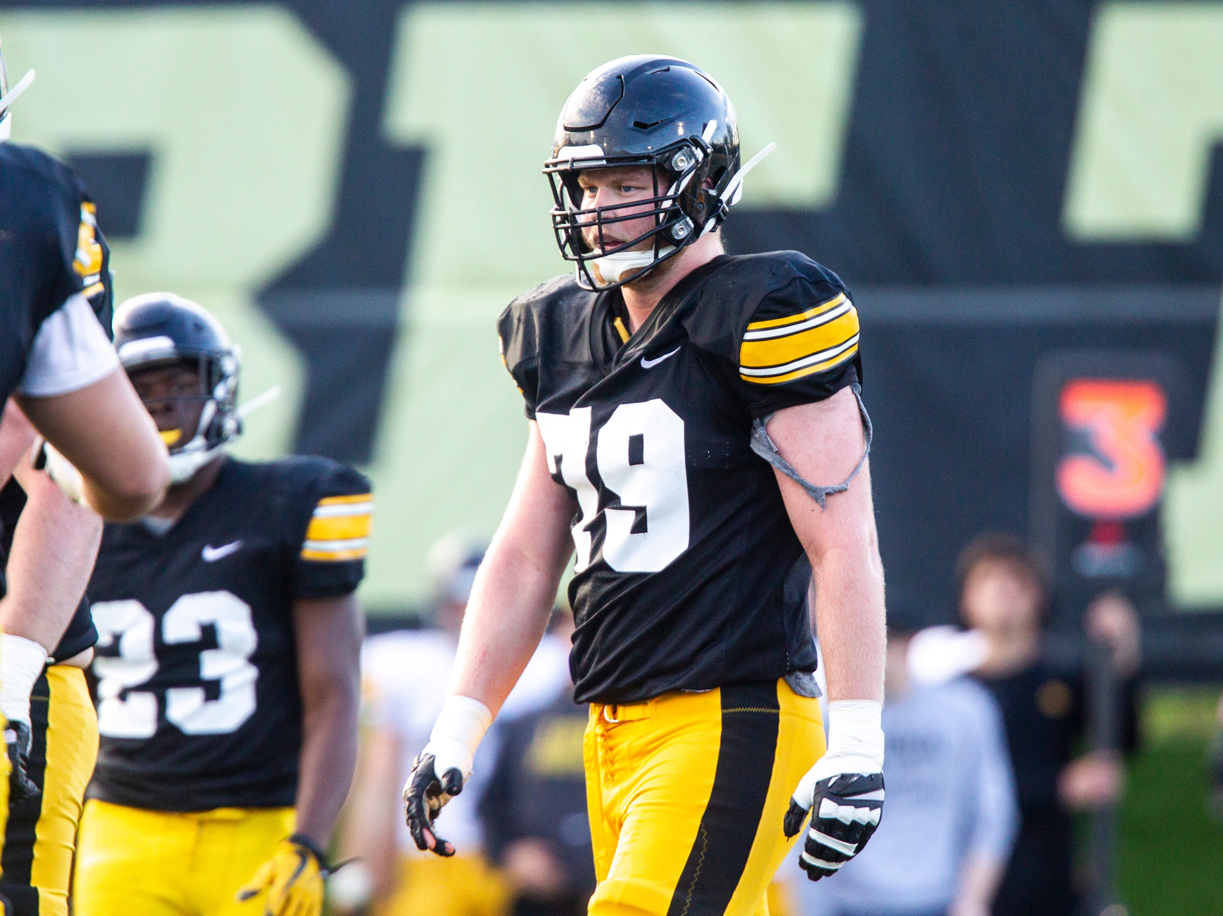 Iowa offensive lineman Jack Plumb (79) walks up to the line during the final spring football practice, Friday, April 26, 2019, at the University of Iowa outdoor practice facility in Iowa City, Iowa.