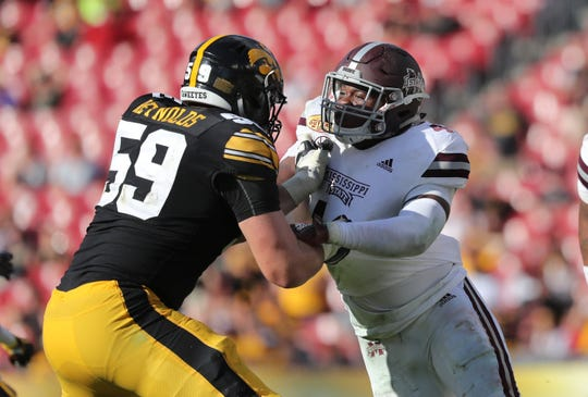 Jan 1, 2019; Tampa, FL, USA;Mississippi State Bulldogs defensive end Gerri Green (4) rushes as Iowa Hawkeyes defensive end Nathan Nelson (59) blocks during the second half in the 2019 Outback Bowl at Raymond James Stadium. Mandatory Credit: Kim Klement-USA TODAY Sports
