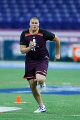 Mar 1, 2019; Indianapolis, IN, USA; Utah offensive lineman Jackson Barton (OL04) goes through workout drills during the 2019 NFL Combine at Lucas Oil Stadium. Mandatory Credit: Brian Spurlock-USA TODAY Sports