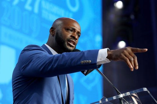 Former Indianapolis Colts player Reggie Wayne announces the team's pick during the second round of the NFL football draft, in Nashville, Tenn. on Friday, April 26, 2019. (AP Photo/Gregory Payan)