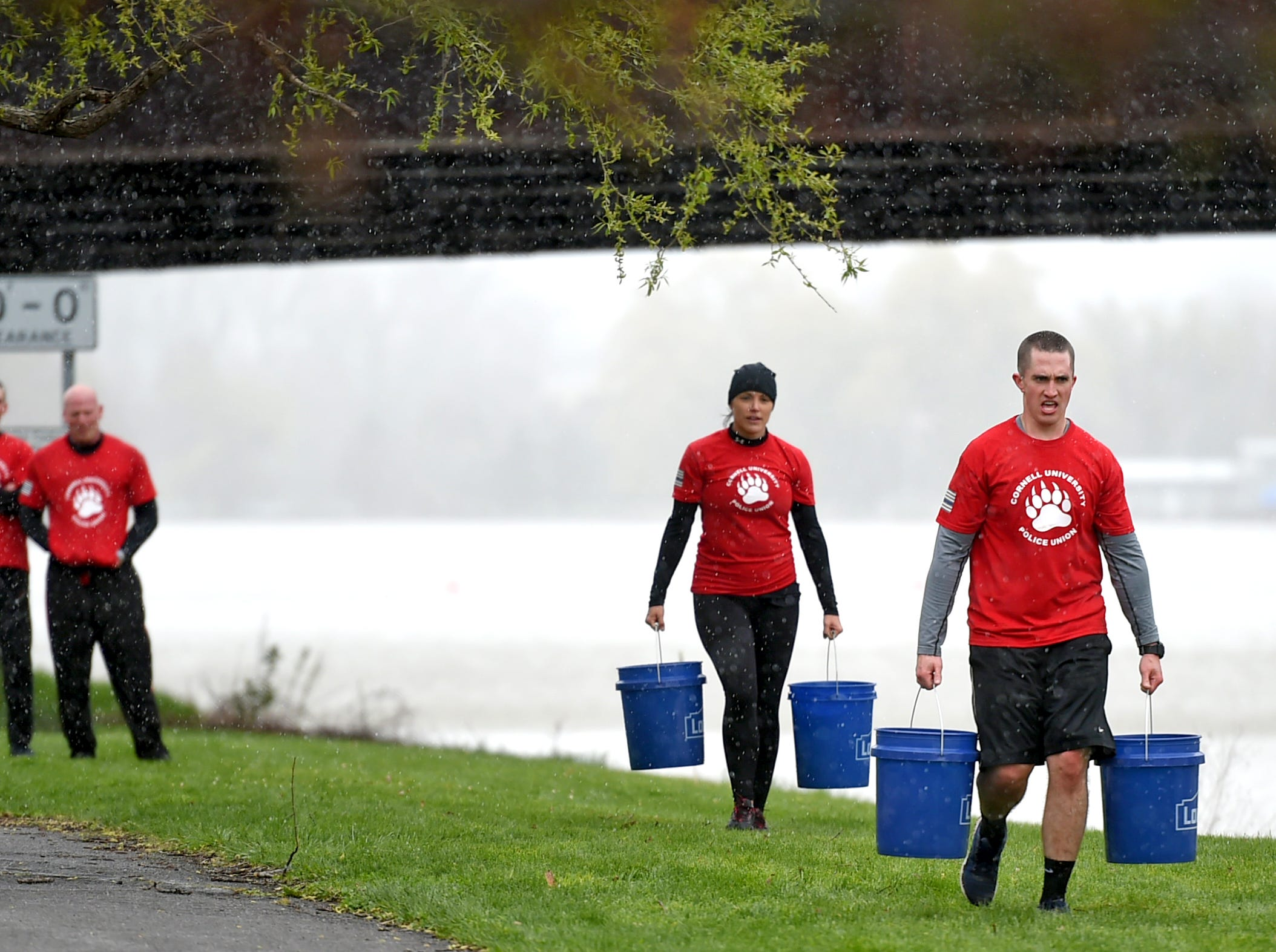 Members of the Cornell University law enforcement community were among the first responders participating in Saturday's Mud, Sweat and Cheers Extreme Fitness Challenge in Ithaca. The race honors Marine Cpl. Christopher Bordoni, an Ithaca native who died in 2012 after being wounded while conducting combat operations in Afghanistan.
