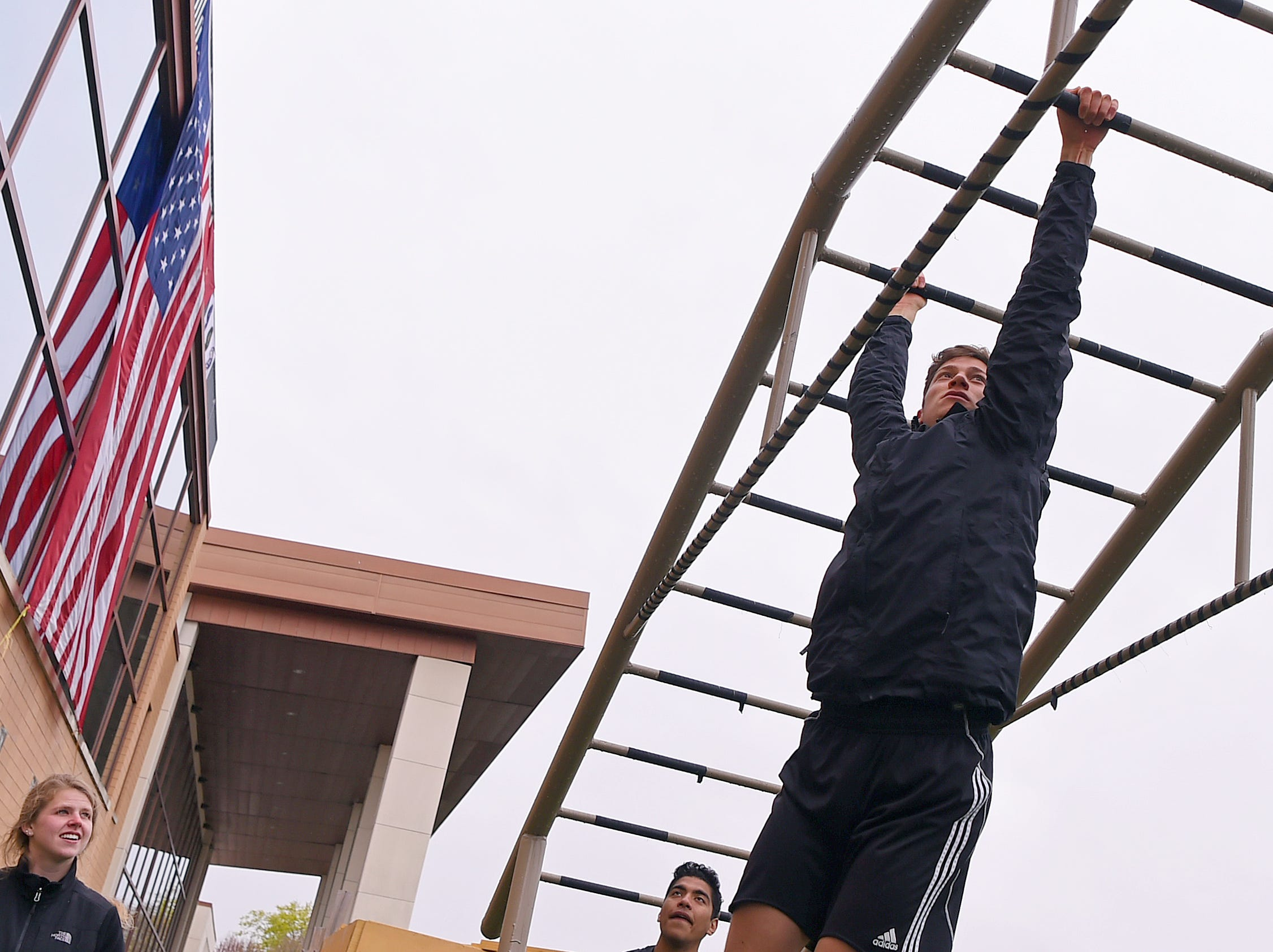 Michael Galbato, a Cornell student, on the first obstacle of the  Mud, Sweat and Cheers Extreme Fitness Challenge at Island Health and Fitness in Ithaca on Saturday, April 27, 2019. The 5K obstacle course race is held annually in honor of Marine Cpl. Christopher Bordoni, an Ithaca native who died in 2012 after being wounded while conducting combat operations in Afghanistan.