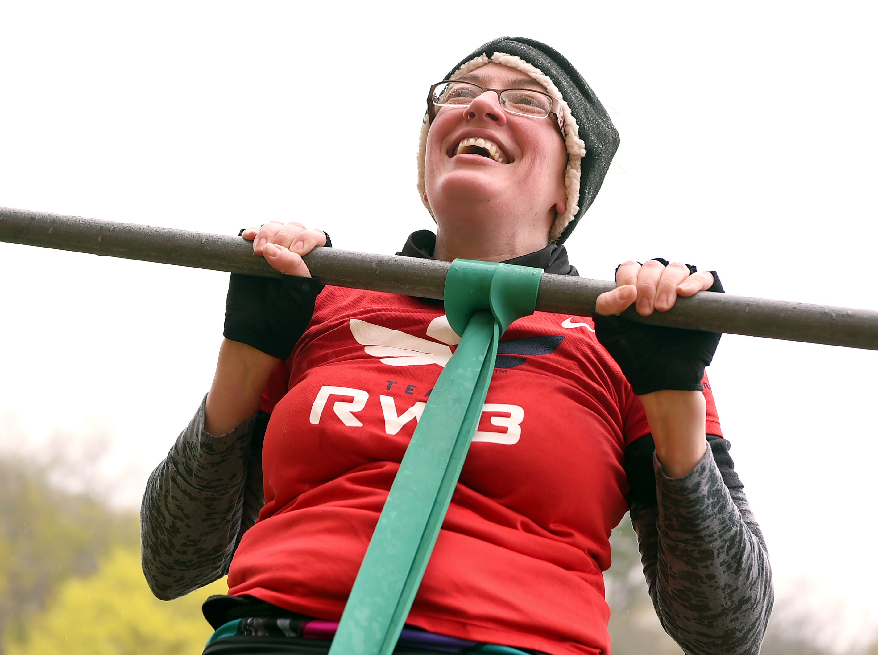 Danielle Price of Ithaca does a pull-up on the first obstacle of the Mud, Sweat and Cheers Extreme Fitness Challenge, held on Saturday, April 27, 2019 at Island Health and Fitness in Ithaca. The 5K obstacle course race is held in honor of Marine Cpl. Christopher Bordoni, an Ithaca native who died in 2012 after being wounded while conducting combat operations in Afghanistan.