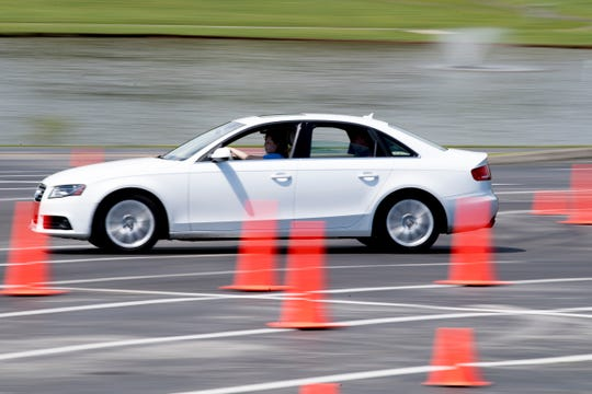 Evelyn Williamson drives around a turn with Michael Washington during a Street Survival training course at Pellissippi State Community College in Hardin Valley in Knoxville, Tennessee on Saturday, April 27, 2019. Street Survival teaches teens how to drive in emergency situations using an obstacle course while driving their own vehicles.