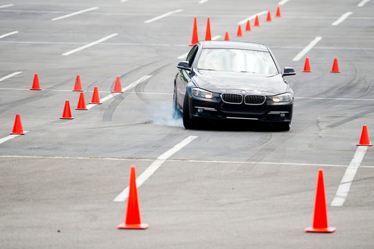 A driver screeches around an obstacle during a Street Survival training course at Pellissippi State Community College in Hardin Valley in Knoxville, Tennessee on Saturday, April 27, 2019. Street Survival teaches teens how to drive in emergency situations using an obstacle course while driving their own vehicles.