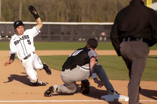 Purdue short stop Evan Albrecht (5) slides into third during the fourth inning of a NCAA baseball game, Friday, April 26, 2019 at Alexander Field in West Lafayette.
