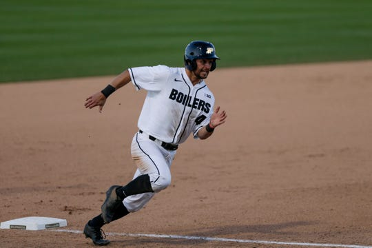 Purdue center fielder Skyler Hunter (4) rounds third to score during the seventh inning of an NCAA baseball game, Friday, April 26, 2019, at Alexander Field in West Lafayette.