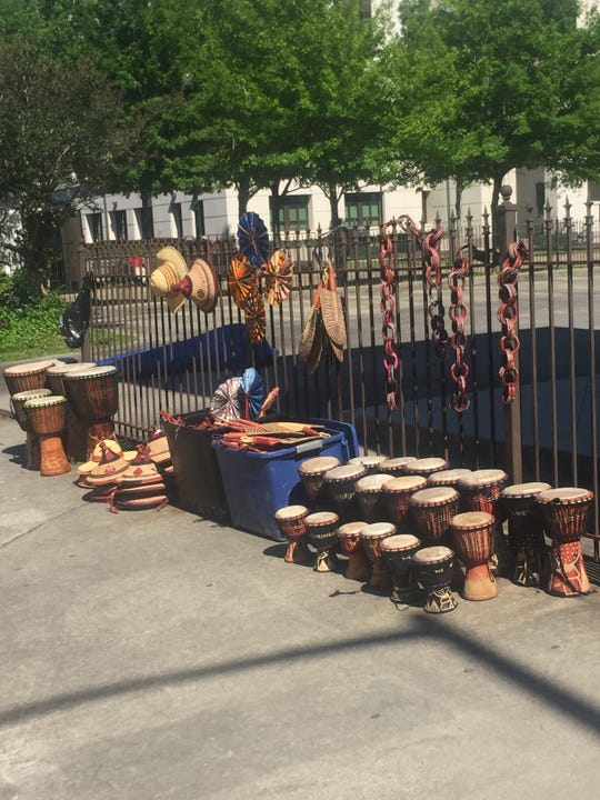 Drums and hats sold at Festival International de Louisiane