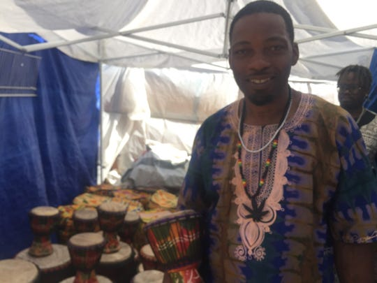 Al Bentley, of Gambia Connections, sells instruments from Ghana