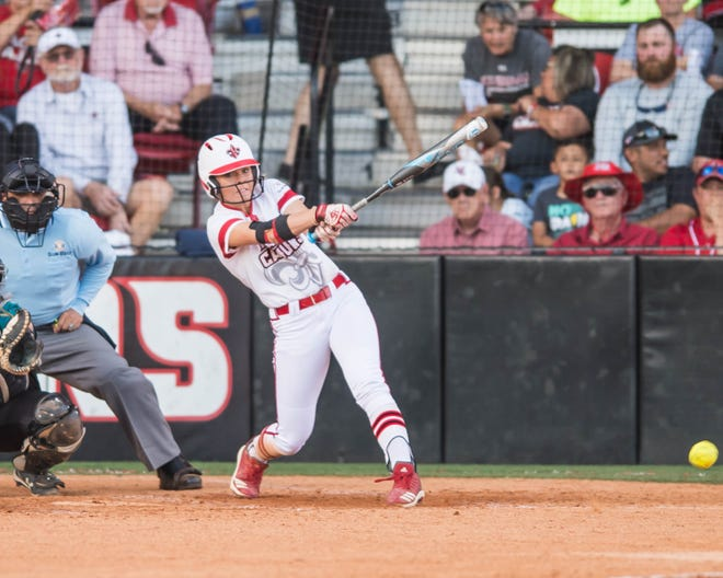 UL's Casidy Chaumont makes contact with the ball for a base hit as the Ragin' Cajuns play Coastal Carolina in the first of a three-game series at Lamson Park on Friday, April 26, 2019.