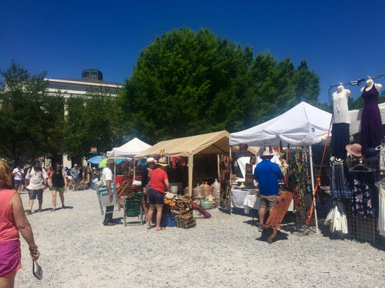 Marche du Monde vendor area is packed with travelers and locals selling goods