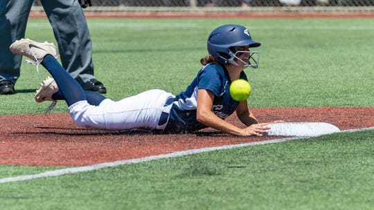St. Thomas More's Molli Perry hits a triple and slides into home as the STM Cougars take on Hannan in the LHSAA State Tournament semifinals Friday, April 26, 2019.