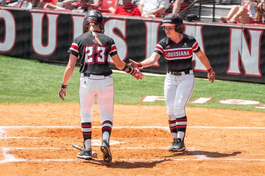 UL's Julie Rawls (23) congratulates Keeli Milligan (right) after her score as the Ragin' Cajuns take on the Coastal Carolina Chanticleers at Yvette Girouard Field on Saturday, April 27, 2019.
