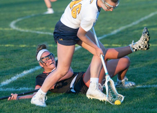 Erika Beauchamp of Hartland scoops up a dropped ball by Brighton's India Lange on Friday, April 26, 2019.
