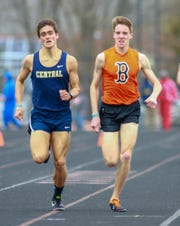 Brighton's Jack Spamer (right) holds off  Chris Allen of Walled Lake Central to win the 1,600-meter run by 0.02 seconds at the Brighton Bulldog Invitational on Saturday, April 27, 2019.