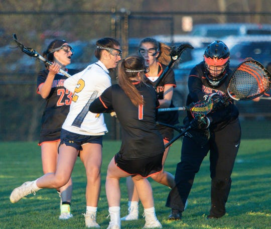 Surrounded by Brighton defenders, Hartland's Elena Salazar scores one of her seven goals in a 16-8 victory on Friday, April 26, 2019.