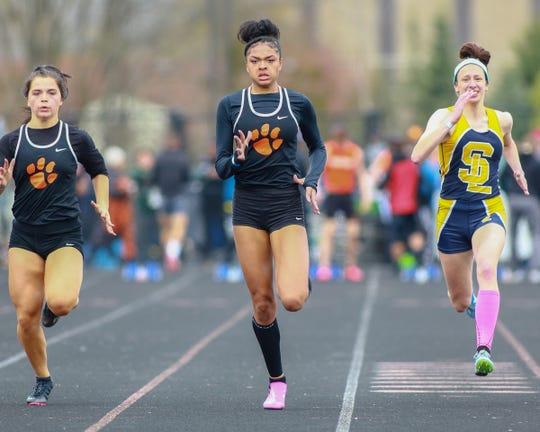 Brighton's Brooke Gray (center) won the 100-meter dash in 12.58 seconds at the Brighton Bulldog Invitational on Saturday, April 27, 2019.