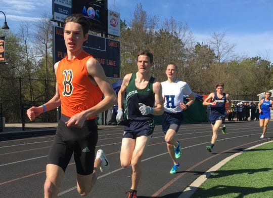 Brighton's Zach Stewart (front) held off Hartland's Riley Hough (third in picture) to win the 3,200-meter run at the Brighton Invitational on Saturday, April 27, 2019.