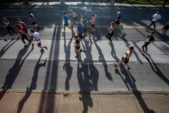 KDF miniMarathon runners cast long shadows from the morning sun on Saturday. 4/26/19