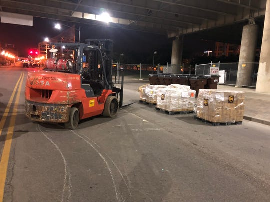 Pallets of Kentucky Derby Festival 2019 marathon and mini marathon medals are unloaded near the finish line hours before the April 27 race began.