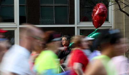Signs of affection for the runners can be found along the course of the 2019 KDF Mini/Marathon race in Louisville on April 27.