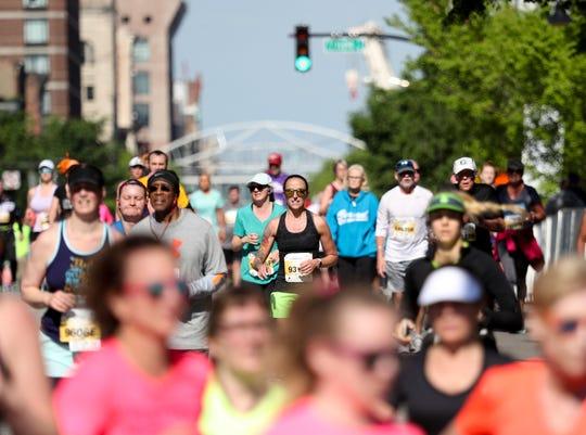 Runners participate in the 2019 KDF Mini/Marathon race in Louisville on April 27.