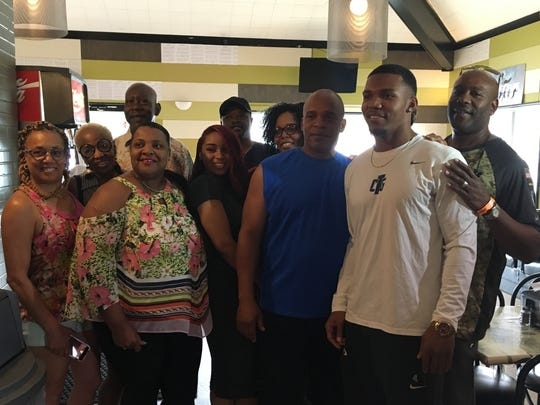 Tony Pollard is surrounded by his family at Pollard's BBQ as they celebrate him being drafted by the Dallas Cowboys in the fourth round.