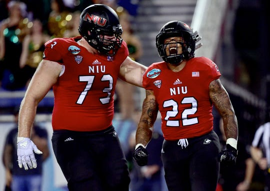 Northern Illinois Huskies offensive tackle Max Scharping (left) celebrates with running back Tre Harbison after a touchdown in the Boca Raton Bowl.
