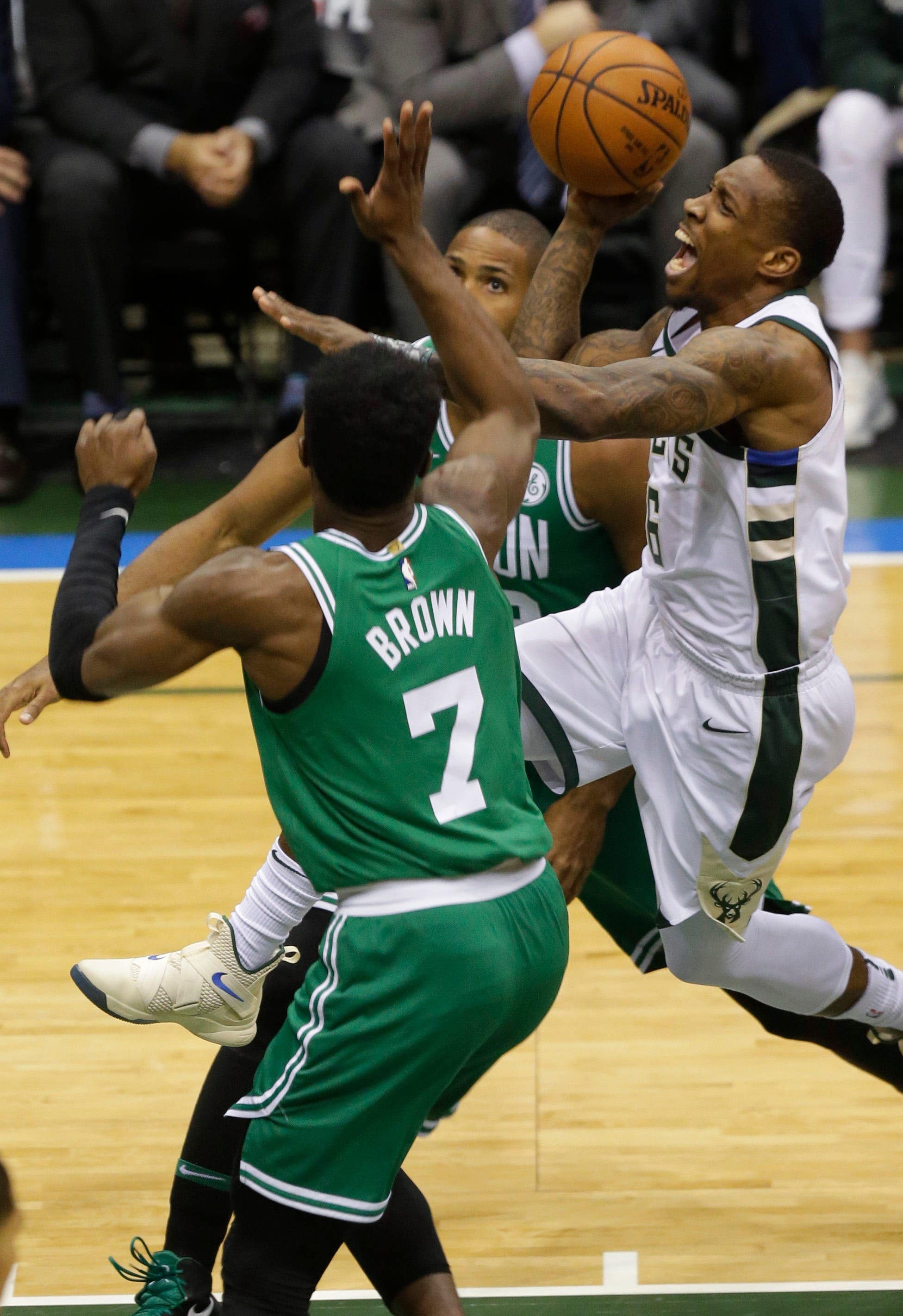 Bucks guard Eric Bledsoe threads his way through Celtics defenders during their playoff series last year.
