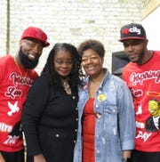 Dameion Perkins, from left, U.S. Rep. Gwen Moore, Maria Hamilton and Nate Hamilton pose for a photo at Dontre Day. Perkins and Nate Hamilton are Dontre Hamilton's brothers. Maria Hamilton is Dontre Hamilton's mother.
