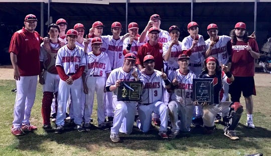 The Flippin Bobcats pose with their trophies after winning the 2A-1 District baseball tournament on Friday night at Harrison.