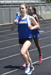 Mountain Home's Emma Martin runs a leg of the 4x800 relay on Friday night at the 5A-East track meet.