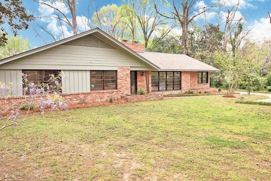 One home in McGehee Estates is for sale for $308,500 and includes four bedrooms, two full bathrooms and two half baths, including a half bath at the swimming pool. The home measures 3,151 square feet of living space.